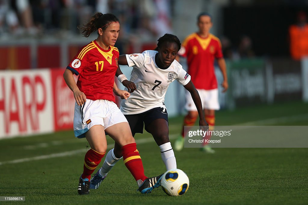 Eniola Aluko of England (R) challenges Elisabeth Ibarra of Spain (L) during the UEFA Women's EURO 2013 Group C match between England and Spain at Linkoping Arena on July 12, 2013 in Linkoping, Sweden.