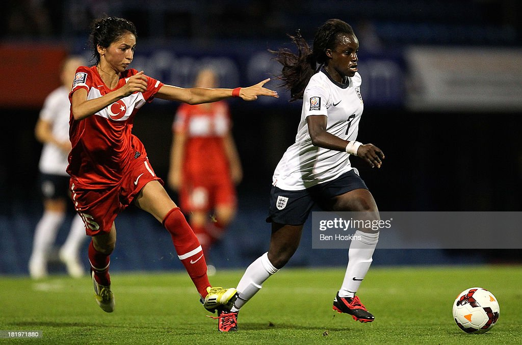 <a gi-track='captionPersonalityLinkClicked' href=/galleries/search?phrase=Eniola+Aluko&family=editorial&specificpeople=234686 ng-click='$event.stopPropagation()'>Eniola Aluko</a> of England holds off pressure from Sibel Duman of Turkey during the FIFA Women's World Cup 2015 Group 6 Qualifier match between England and Turkey at Fratton Park on September 26, 2013 in Portsmouth, England.