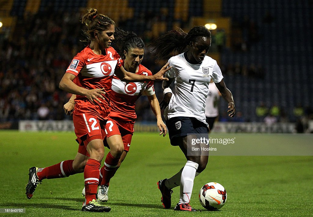 <a gi-track='captionPersonalityLinkClicked' href=/galleries/search?phrase=Eniola+Aluko&family=editorial&specificpeople=234686 ng-click='$event.stopPropagation()'>Eniola Aluko</a> of England holds off pressure from Songul Ece (L) and Bilgin Defterli (R) of Turkey during the FIFA Women's World Cup 2015 Group 6 qualifier between England and Turkey at Fratton Park on September 26, 2013 in Portsmouth, England.
