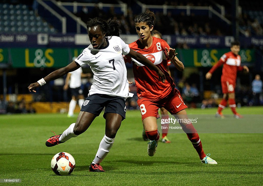 <a gi-track='captionPersonalityLinkClicked' href=/galleries/search?phrase=Eniola+Aluko&family=editorial&specificpeople=234686 ng-click='$event.stopPropagation()'>Eniola Aluko</a> of England holds off pressure from Yagmur Uraz of Turkey during the FIFA Women's World Cup 2015 Group 6 qualifier between England and Turkey at Fratton Park on September 26, 2013 in Portsmouth, England.