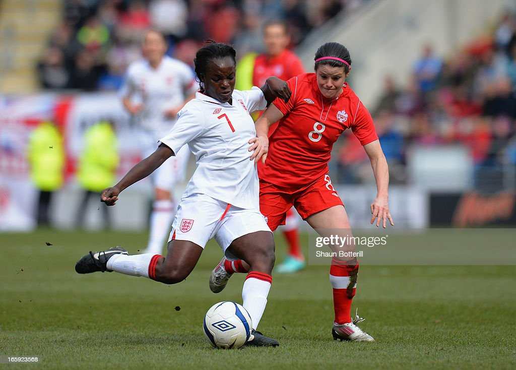 <a gi-track='captionPersonalityLinkClicked' href=/galleries/search?phrase=Eniola+Aluko&family=editorial&specificpeople=234686 ng-click='$event.stopPropagation()'>Eniola Aluko</a> of England is challenged by <a gi-track='captionPersonalityLinkClicked' href=/galleries/search?phrase=Diana+Matheson&family=editorial&specificpeople=2473518 ng-click='$event.stopPropagation()'>Diana Matheson</a> of Canada during the Women's International Match between England Women and Canada Women at The New York Stadium on April 7, 2013 in Rotherham, England.