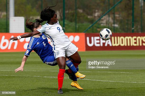 Eniola Aluko of England is challenged by Marija Aleksic of Bosnia during the UEFA Women's European Championship Qualifier at FF BIH Football Training...