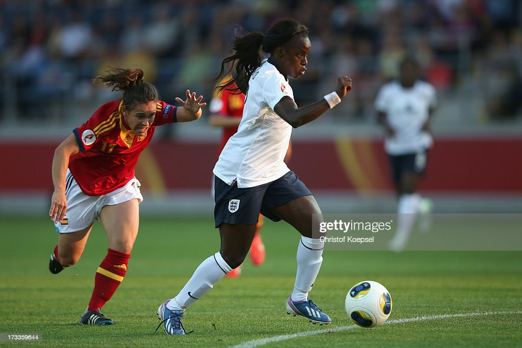 Eniola Aluko of England (R) scores the first goal against Elisabeth Ibarra of Spain (L) during the UEFA Women's EURO 2013 Group C match between England and Spain at Linkoping Arena on July 12, 2013 in Linkoping, Sweden.