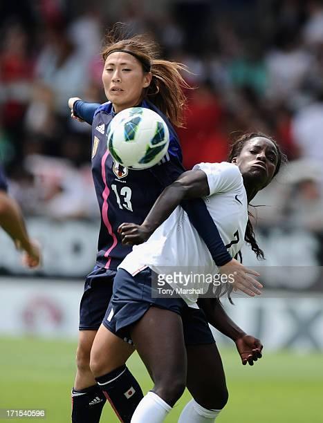 Eniola Aluko of England tackled by Rumi Utsugi of Japan during the England Women v Japan Women Womens' International Match at Pirelli Stadium on June...