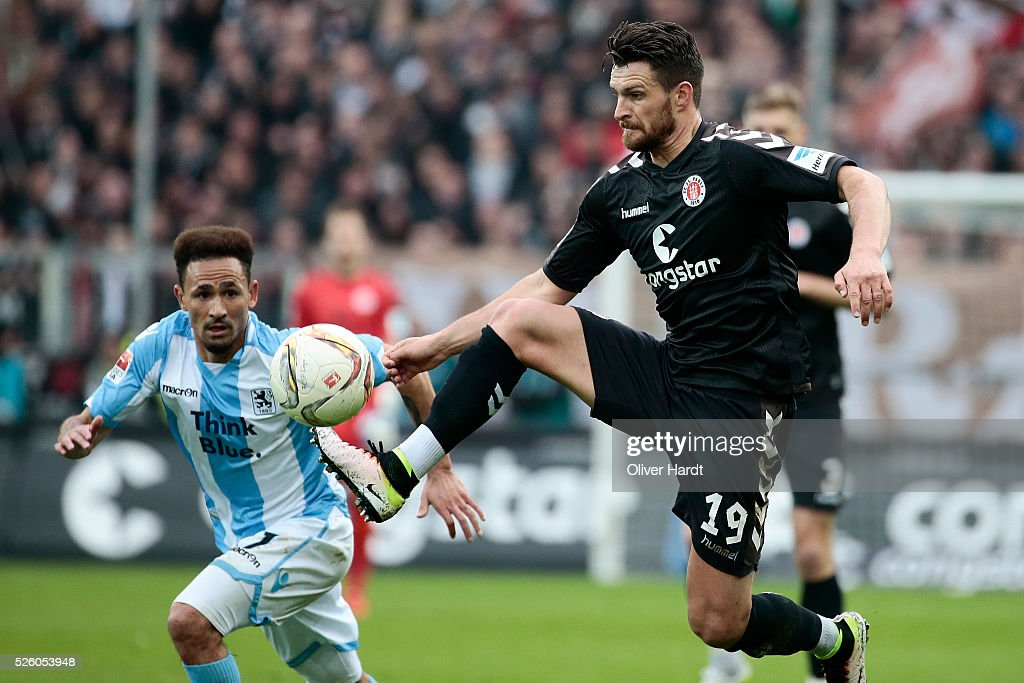 Enis Alushi (R) of Hamburg and Dayton Claasen (L) of Muenchen compete for the ball during the Second Bundesliga match between FC St. Pauli and 1860 Muenchen at Millerntor Stadium on April 29, 2016 in Hamburg, Germany.