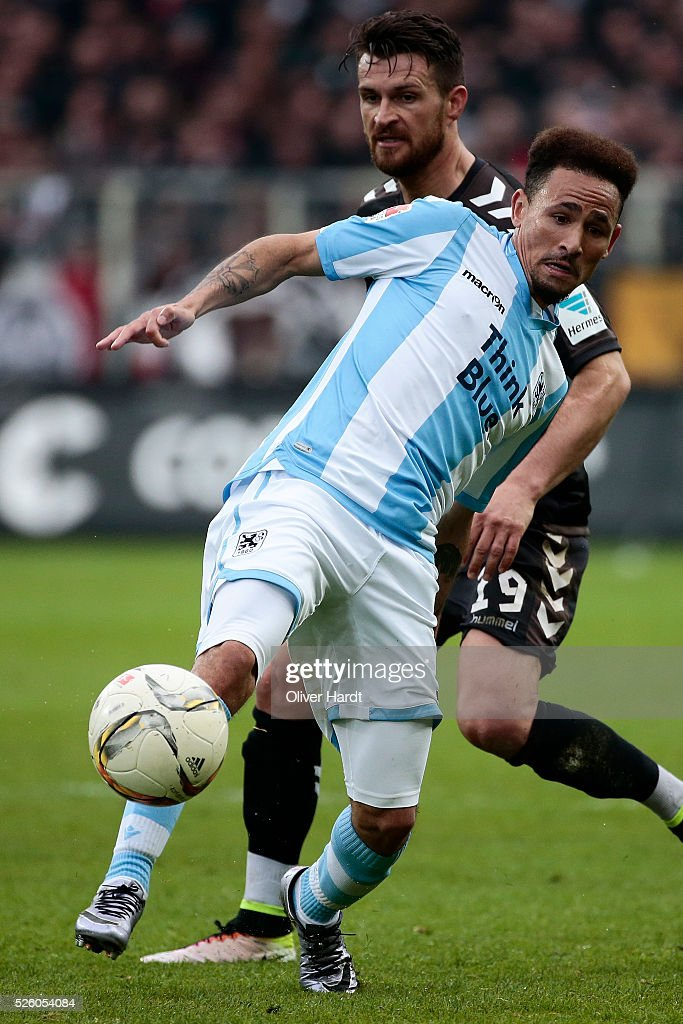 Enis Alushi (L) of Hamburg and Dayton Claasen (R) of Muenchen compete for the ball during the Second Bundesliga match between FC St. Pauli and 1860 Muenchen at Millerntor Stadium on April 29, 2016 in Hamburg, Germany.