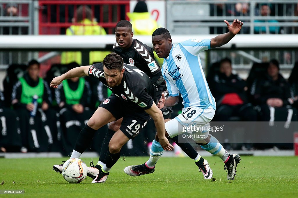 Enis Alushi (L) of Hamburg and Florent Romuald Lacazette (R) of Muenchen compete for the ball during the Second Bundesliga match between FC St. Pauli and 1860 Muenchen at Millerntor Stadium on April 29, 2016 in Hamburg, Germany.