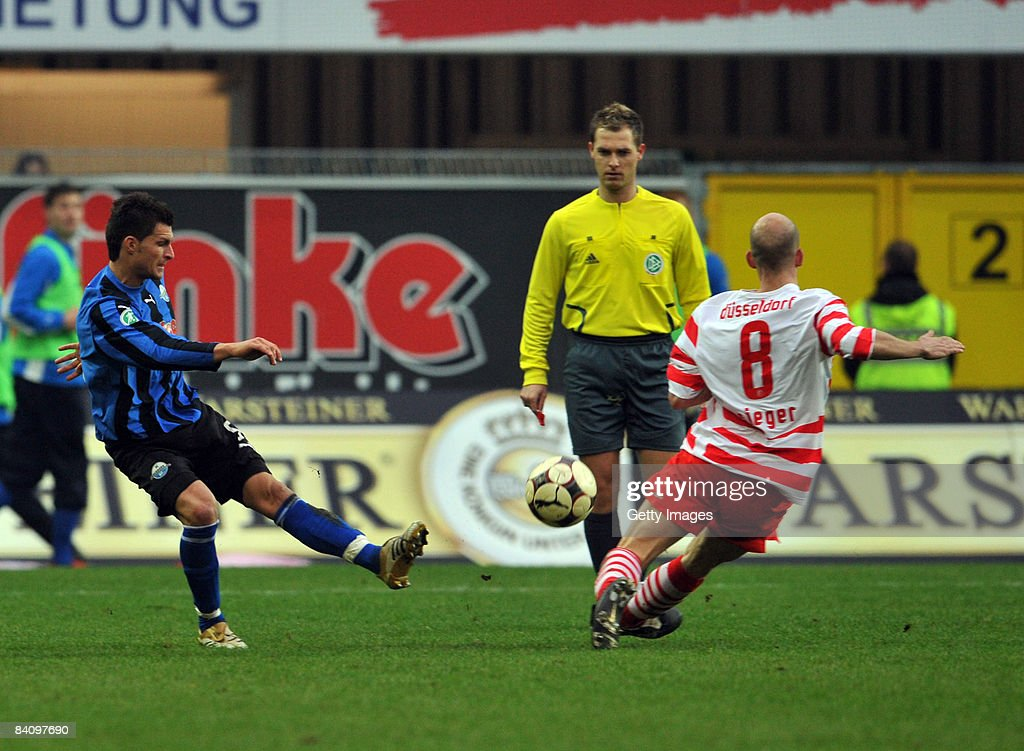 Enis Alushi of Paderborn and Stephan Sieger of Duesseldorf during the 3 Liga match between SC Paderborn and Fortuna Duesseldorf at the Paragon Arena...