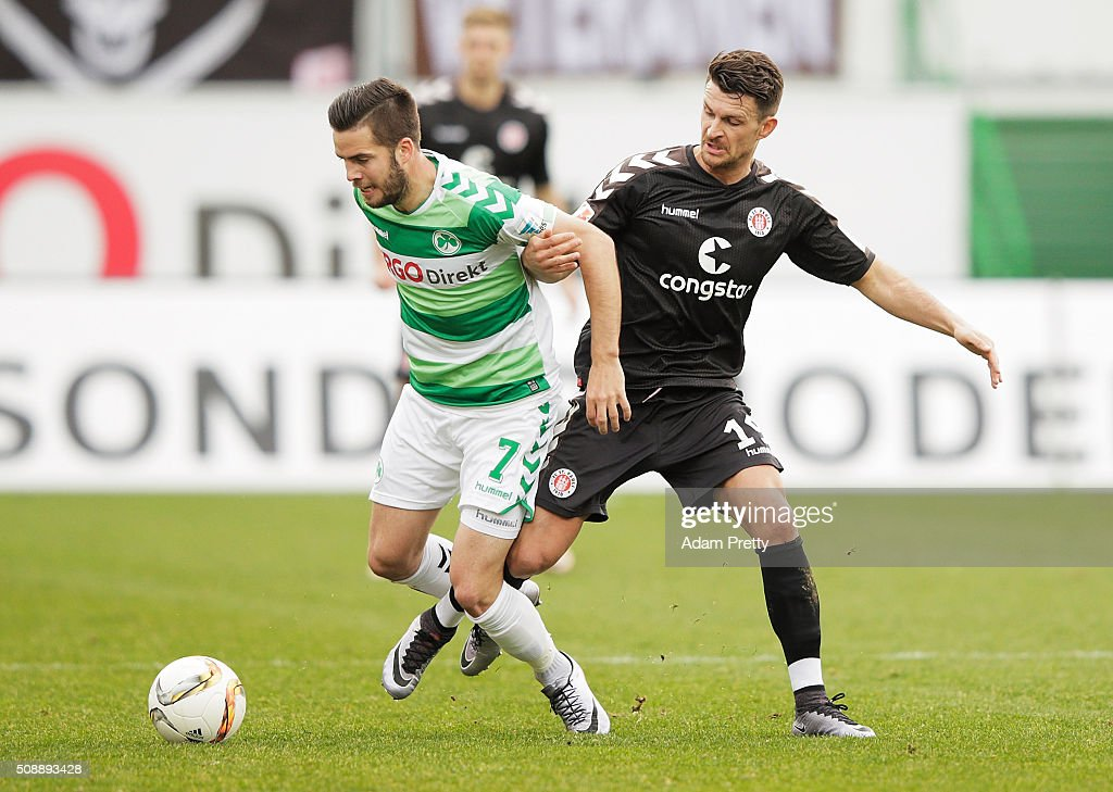 Enis Alushi of St Pauli tackles Niko Giesselmann of Greuther Furth before the 2. Bundesliga match between Greuther Fuerth and FC St. Pauli at Stadion am Laubenweg on February 7, 2016 in Fuerth, Germany.