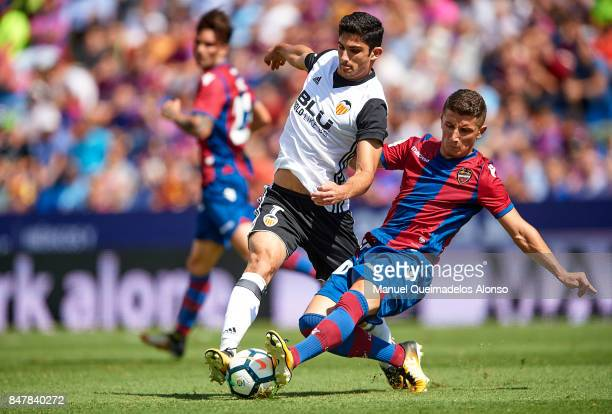 Enis Bardhi of Levante competes for the ball with Goncalo Guedes of Valencia during the La Liga match between Levante and Valencia at Ciutat de...