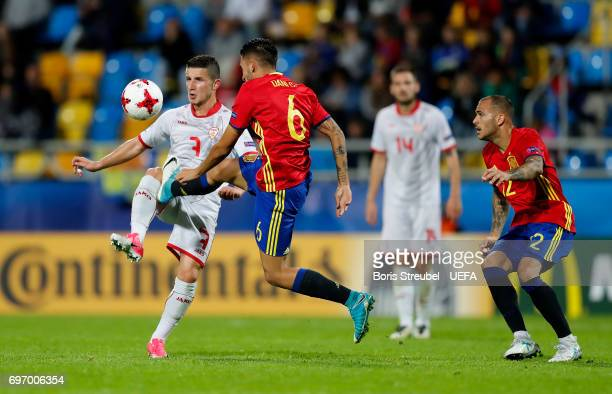 Enis Bardi of FYR Macedonia battles for the ball with Dani Ceballos of Spain during the UEFA European Under21 Championship match between Spain and...