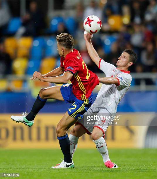 Enis Bardi of FYR Macedonia battles for the ball with Marcos Llorente of Spain during the UEFA European Under21 Championship match between Spain and...