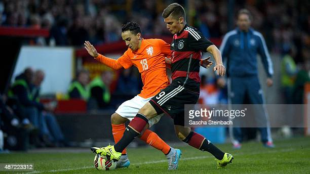Enis Bunjaki of Germany battles for the ball with Abdelhak Nouri of Netherlands during the U19 international friendly match between Netherlands and...
