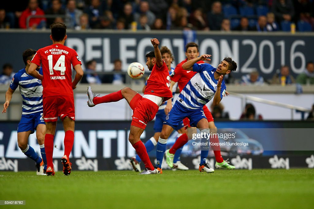 Enis Hajri of Duisburg (R) challenges Elia Soriano of Wuerzburg (L) during the Second Bundesliga play-off second leg match between MSV Duisburg and Wuerzburger Kickers at Schauinsland-Reisen-Arena on May 24, 2016 in Duisburg, Germany.
