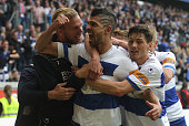 Enis Hajri of Duisburg is hugged by teammates after scoring the second goal during the 3rd Bundesliga match between MSV Duisburg and Holstein Kiel at...