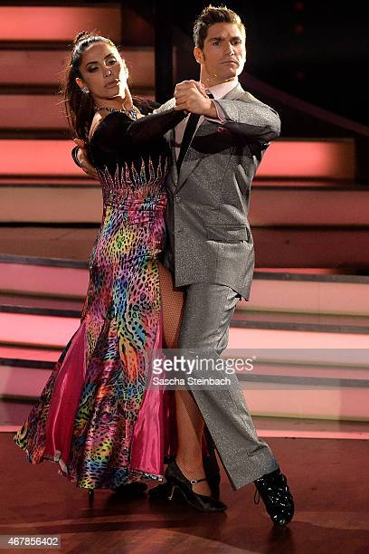 Enissa Amani and Chirstian Polanc perform on stage during the 3rd show of the television competition 'Let's Dance' on March 27 2015 in Cologne Germany