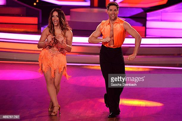 Enissa Amani and Chirstian Polanc perform on stage during the 4th show of the television competition 'Let's Dance' on April 10 2015 in Cologne Germany