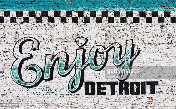 Enjoy Detroit sign on wall