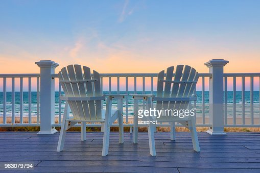 Enjoy the view of the ocean from a chair while on vacation : Stock Photo