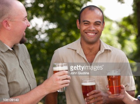 Enjoying a beer. : Stock Photo