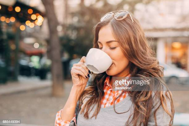 Enjoying a cup of coffee at the cafe