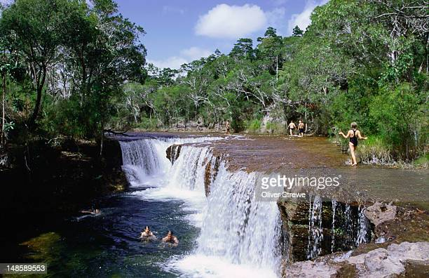 Enjoying a dip in the clear waters at Eliot Falls, in the northern tip of Cape York Peninsula