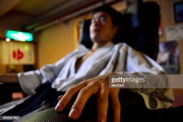 Enjoying a massage chair
