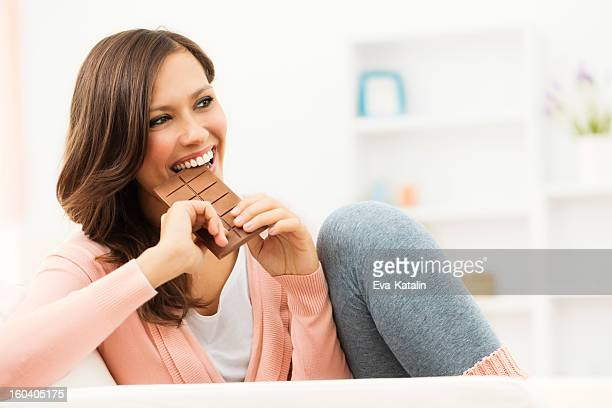 Enjoying a piece of chocolate
