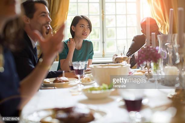 Enjoying and celebrating dinner together.