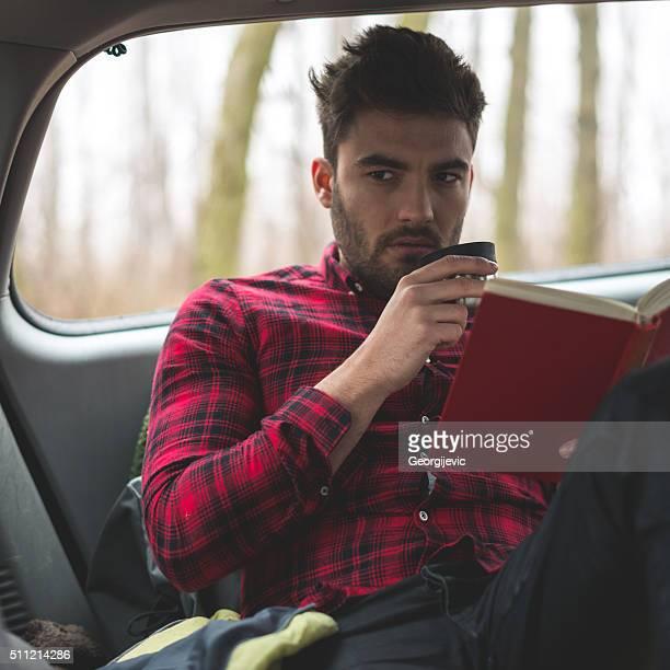 Enjoying coffee and book