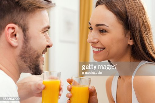 Enjoying fresh juice together. : Stock Photo