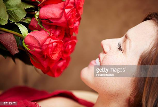 Enjoying the aroma of fresh roses