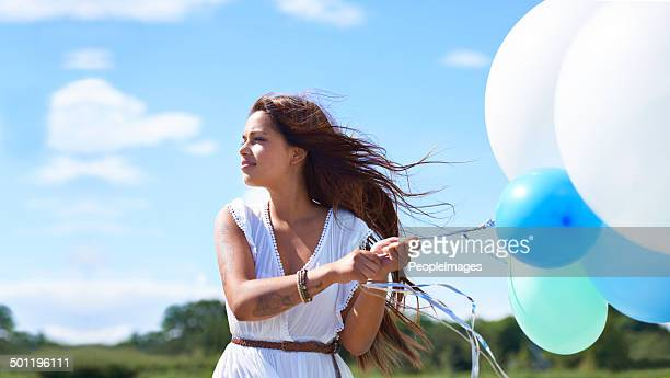 Enjoying the day with her baloons