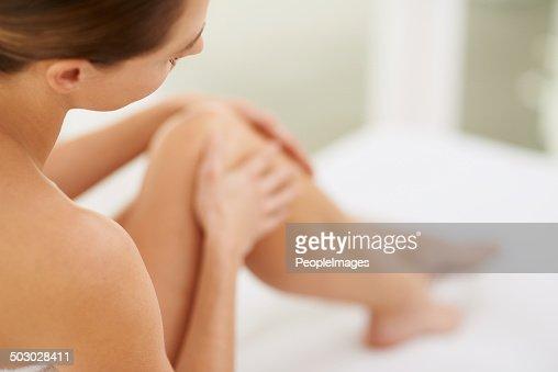 Enjoying the sensation of her skin