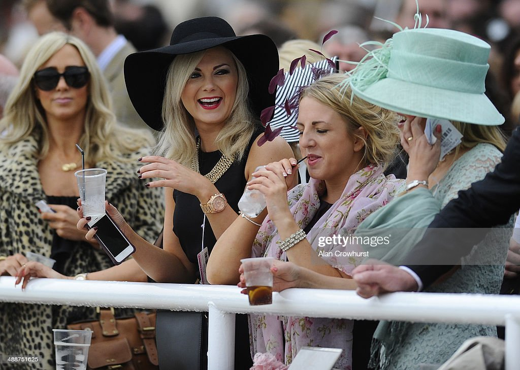 Enjoying themselves on Ladies Day at Chester racecourse on May 08, 2014 in Chester, England.
