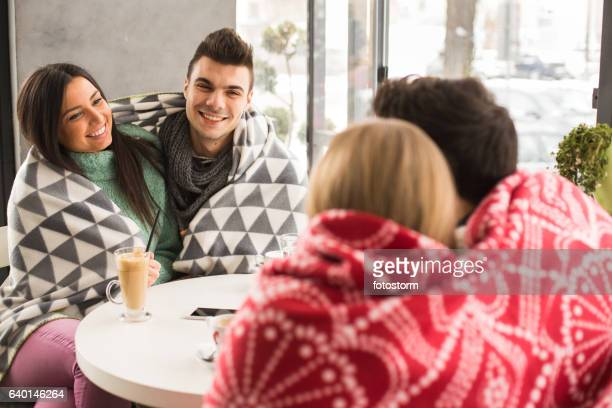 Enjoying winter day in caffee with friends