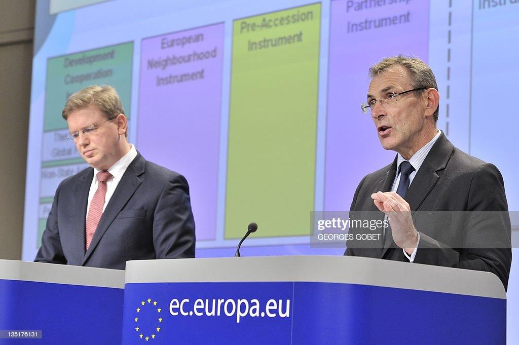 EU enlargement commissioner Stefan Fuele and EU development commissioner Andris Piebalgs give a press conference on December 7 2011 at EU...