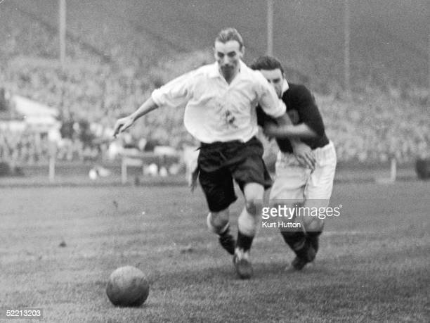 Enlgish outside right Stanley Matthews grapples with Scottich defender Stephens during an international fixture between England and Scotland at...