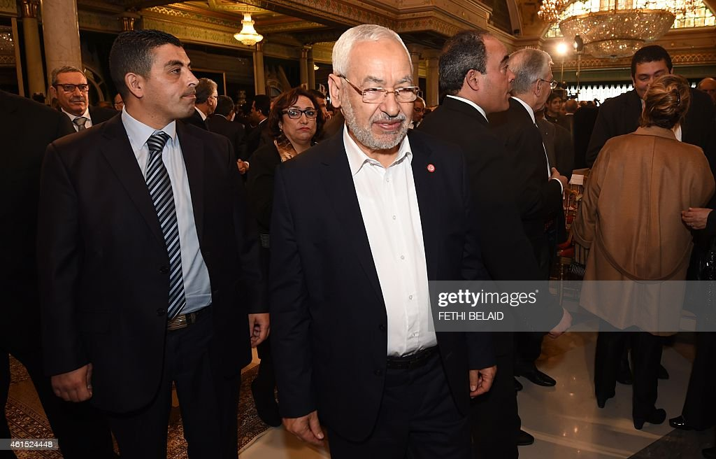 Ennahdha Islamist Party Leader Rached Ghannouchi (C) looks on during an event in Tunis on January 14, 2015, marking the fourth anniversary of the ousting of Tunisia's longtime ruler Zine el Abidine Ben Ali, that sparked the Arab Spring uprisings. On January 14 2011, under massive popular pressure over unemployment and inflation, Ben Ali fled to Saudi Arabia with his family after 23 years in power.