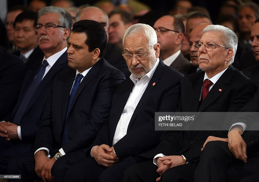 Ennahdha Islamist Party Leader Rached Ghannouchi (2R), new Tunisian Prime minister Habib Essid (R), and Nidaa Tounes General Secretary Taieb Baccouche(2L) look on during an event in Tunis on January 14, 2015, marking the fourth anniversary of the ousting of Tunisia's longtime ruler Zine el Abidine Ben Ali, that sparked the Arab Spring uprisings. On January 14 2011, under massive popular pressure over unemployment and inflation, Ben Ali fled to Saudi Arabia with his family after 23 years in power.