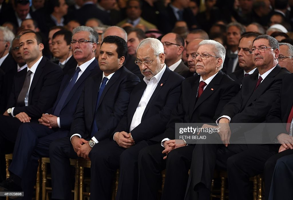 Ennahdha Islamist Party Leader Rached Ghannouchi (C), new Tunisian Prime minister Habib Essid (R), and Nidaa Tounes General Secretary Taieb Baccouche(2R) look on during an event in Tunis on January 14, 2015, marking the fourth anniversary of the ousting of Tunisia's longtime ruler Zine el Abidine Ben Ali, that sparked the Arab Spring uprisings. On January 14 2011, under massive popular pressure over unemployment and inflation, Ben Ali fled to Saudi Arabia with his family after 23 years in power.