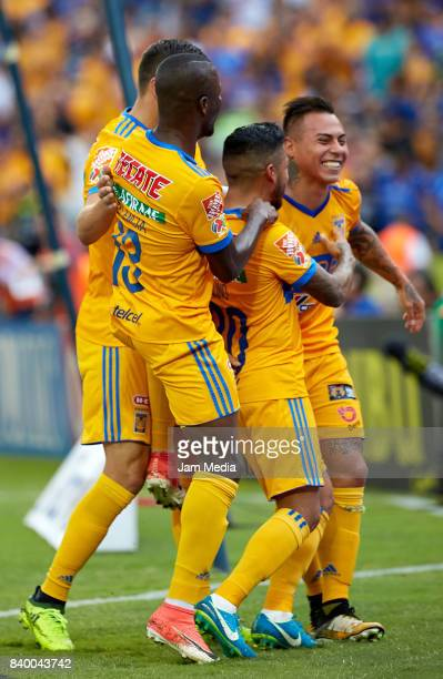 Enner Valencia Javier Aquino and Eduardo Vargas of Tigres his celebrate during the seventh round match between Tigres UANL and Lobos BUAP as part of...
