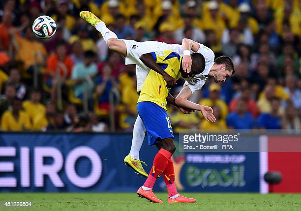Enner Valencia of Ecuador and Morgan Schneiderlin of France compete for the ball during the 2014 FIFA World Cup Brazil Group E match between Ecuador...