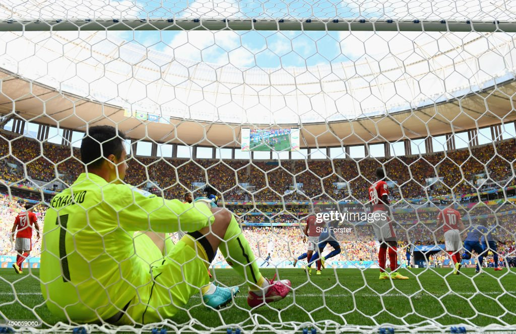 <a gi-track='captionPersonalityLinkClicked' href=/galleries/search?phrase=Enner+Valencia&family=editorial&specificpeople=6898122 ng-click='$event.stopPropagation()'>Enner Valencia</a> of Ecuador (R) celebrates after scoring his team's first goal as <a gi-track='captionPersonalityLinkClicked' href=/galleries/search?phrase=Diego+Benaglio&family=editorial&specificpeople=543817 ng-click='$event.stopPropagation()'>Diego Benaglio</a> of Switzerland looks on from the net during the 2014 FIFA World Cup Brazil Group E match between Switzerland and Ecuador at Estadio Nacional on June 15, 2014 in Brasilia, Brazil.