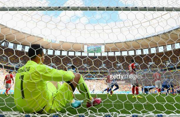 Enner Valencia of Ecuador celebrates after scoring his team's first goal as Diego Benaglio of Switzerland looks on from the net during the 2014 FIFA...
