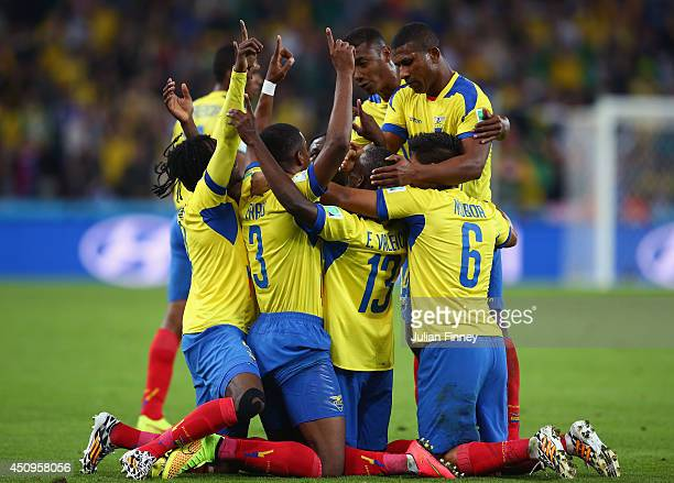 Enner Valencia of Ecuador celebrates with teammates after scoring his team's second goal during the 2014 FIFA World Cup Brazil Group E match between...