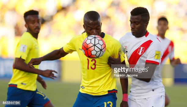 Enner Valencia of Ecuador fights for the ball with Christian Ramos of Peru during a match between Ecuador and Peru as part of FIFA 2018 World Cup...