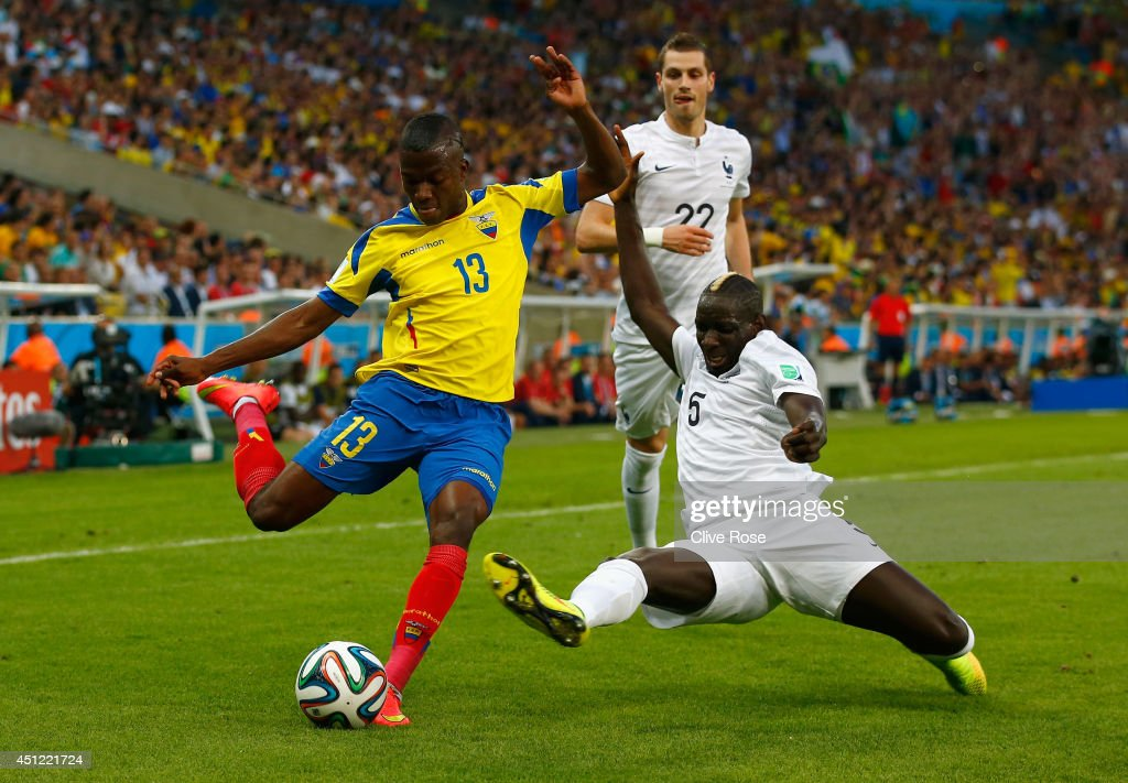 Enner Valencia of Ecuador is challenged by Mamadou Sakho of France during the 2014 FIFA World Cup Brazil Group E match between Ecuador and France at Maracana on June 25, 2014 in Rio de Janeiro, Brazil.