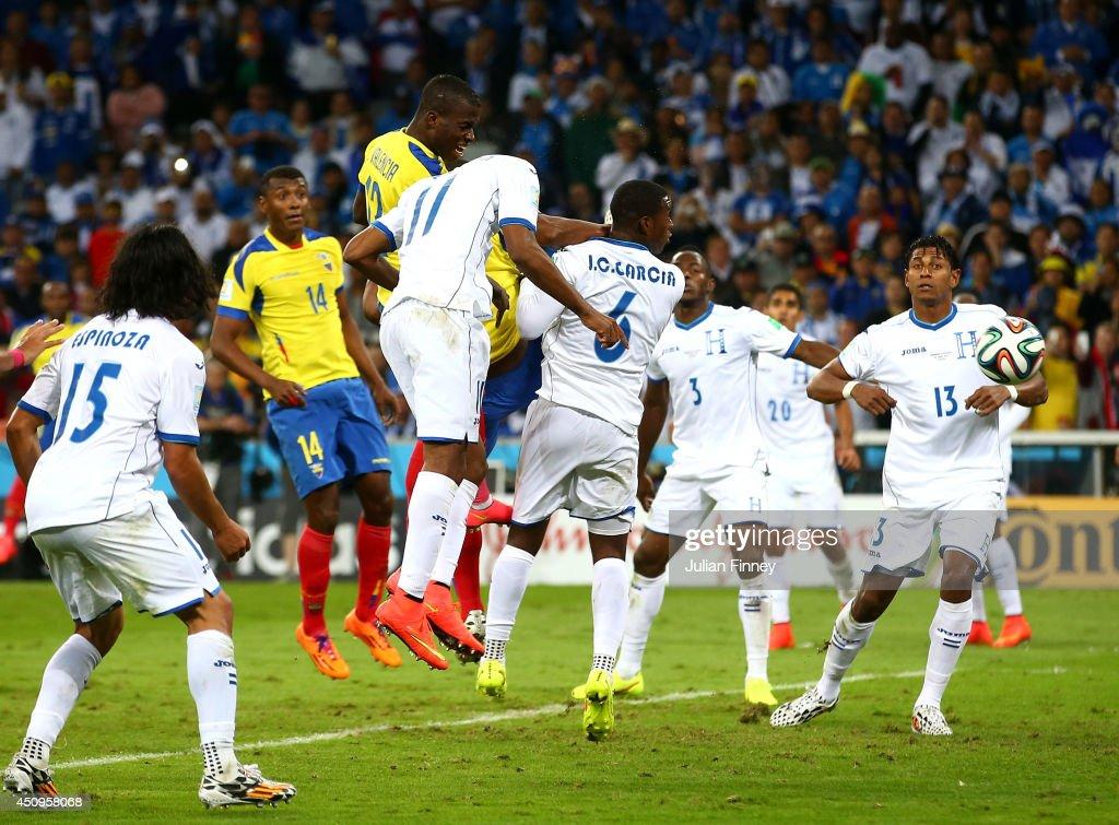 Enner Valencia of Ecuador scores his team's second goal on a header against Jerry Bengtson of Honduras during the 2014 FIFA World Cup Brazil Group E match between Honduras and Ecuador at Arena da Baixada on June 20, 2014 in Curitiba, Brazil.