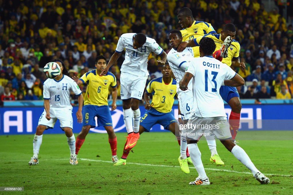 Enner Valencia of Ecuador scores his team's second goal on a header against Jerry Bengtson and Juan Carlos Garcia of Honduras during the 2014 FIFA World Cup Brazil Group E match between Honduras and Ecuador at Arena da Baixada on June 20, 2014 in Curitiba, Brazil.